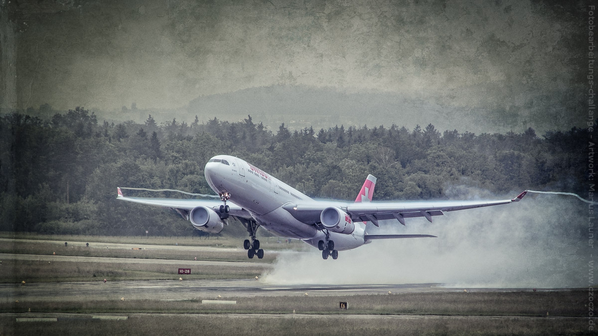 2012-06-03-LSZH-0415-Flugzeug im Regen